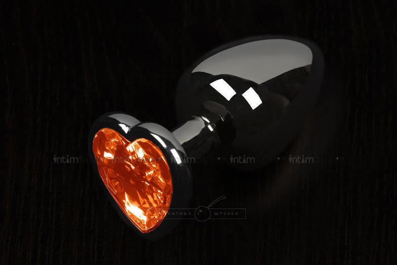 Анальная пробка маленькая Пикантные Штучки с оранжевым кристаллом в виде сердечка, графитовая, 6 см